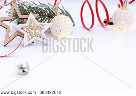 Christmas Composition Of Wooden Stars With Sparkles, Garlands Of White Luminous Balls, Fir Branches