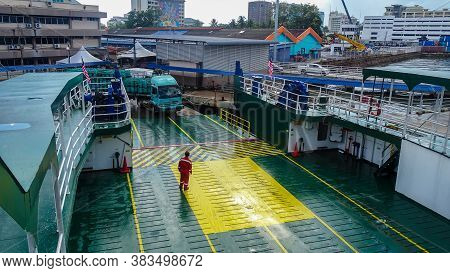 Labuan,malaysia-aug 27,2020:ferry Ship Crew Worker In Coveralls On Duty At Docking On The Ro Ro Ferr