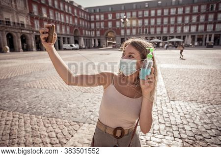 Attractive Happy Young Woman With Face Mask Taking A Selfie. In Covid-19 New Normal And Tourism