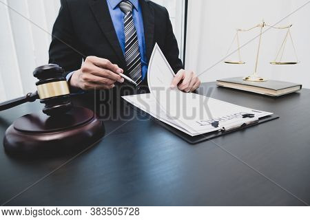 Professional Male Lawyers Work At A Law Office There Are Scales, Scales Of Justice, Judges Gavel, An