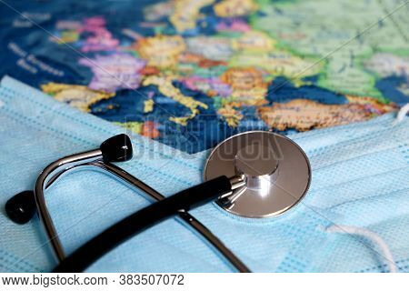 Stethoscope And Medical Masks On Europe Map Background. Concept Of European Health Care, Coronavirus