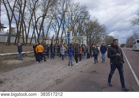 Chernobyl, Ukraine, March 14, 2020. A Large Group Of Tourists. A Group Of Tourists Near The Stele Wi