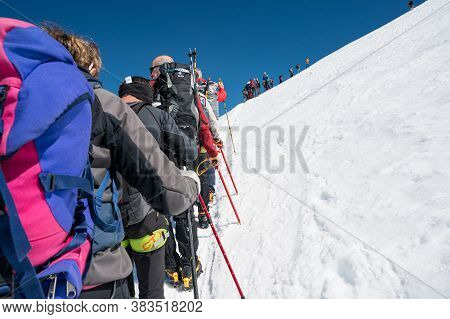 Cervinia, Italy - July 18, 2020: Mountaineers Ascending And Tackling Slopes Of Breithorn - Considere