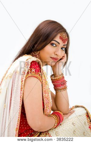 Beautiful Bengali bride in colorful dress day dreaming isolated poster