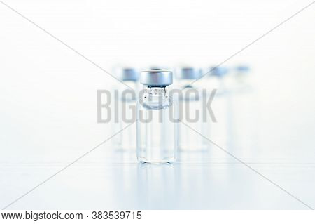 Many Transparent Vials With Vaccine For Covid-19 Coronavirus, Flu, Infectious Diseases. Injection Af