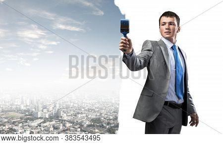 Smiling Creative Businessman Painter Holding Paintbrush In Hand. Portrait Of Joyful Handsome Man In