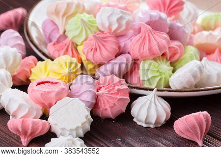 Colorful Sweet Meringue Cookies Assortment On Wooden Table