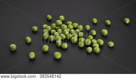 Pile Of Green Peas On Black Background