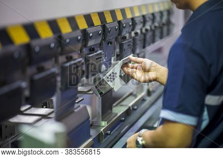 The Operation Of Hydraulic Bending Machine With Technician.  The  Sheet Metal Manufacturing Process
