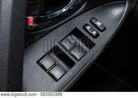 Novosibirsk, Russia - August  07, 2020 : Toyota Rav-4, Interior Of Modern Car. Side Door Buttons: Wi
