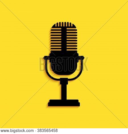 Black Microphone Icon Isolated On Yellow Background. On Air Radio Mic Microphone. Speaker Sign. Long