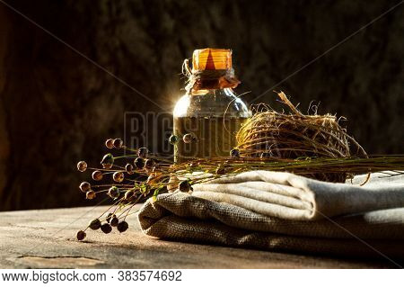 Flax Products. Linseed Oil, Linen Cloth, Rope, And Dry Flax Plants
