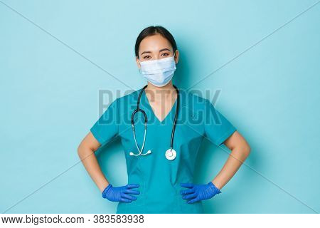Covid-19, Social Distancing And Coronavirus Pandemic Concept. Cheerful Smiling Asian Female Doctor,