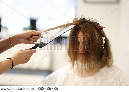 Master Hairdresser Dyes Strands Of Hair For Client In Beauty Salon. Hair Coloring Services Concept