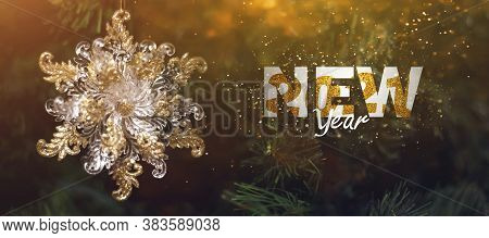 Merry Christmas And Happy New Year Typo Glitter Text On Green Pine Tree With Snowflake. Holiday Cele