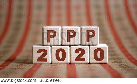 Ppp 2020 Text On Wooden Cubes On A Monochrome Background With Reflection.