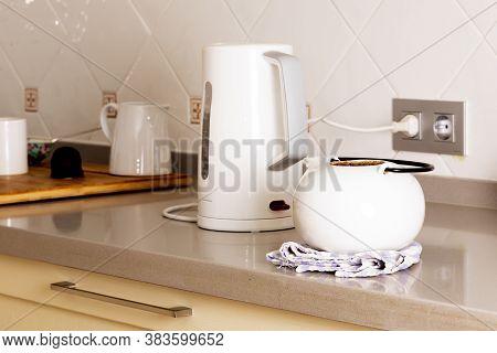 Boiler And Teapot Over A Pristine Domestic Countertop