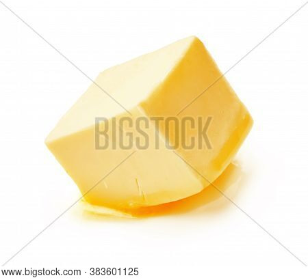 A Piece Of Melting Butter Isolated On White Background. Butter Cube.