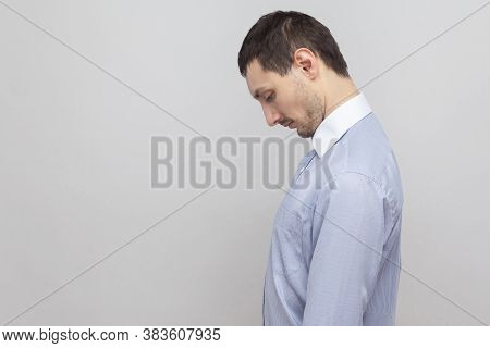Profile Side View Portrait Of Sad Depressed Handsome Bristle Businessman In Classic Blue Shirt Stand
