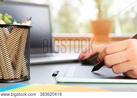 Beautiful Graphic Designer Drawing Digital Design On A Drawing Tablet