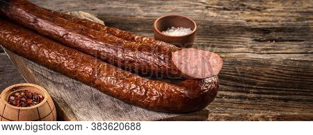 Wiener Sausages On A Wooden Background. Top View. Long Banner Format.