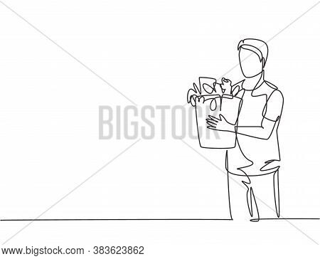Single Continuous Line Drawing Young Happy Attractive Man Holding Groceries Bag Full Of Daily Needs.