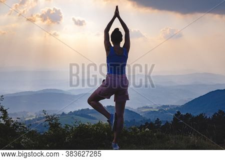 Woman doing yoga in nature. Yoga in nature. Yoga lifestyle. Healthy lifestyle. Woman doing yoga on mountain in nature. Concept of healthy lifestyle. Happy people. Healthy people. Young people. Yoga outdoors in nature.