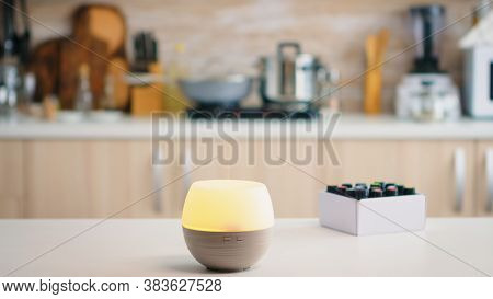 Wellness Aromatherapy Essential Oils Diffuser Diffusing Fragrance Into The Kitchen. Aroma Health Ess