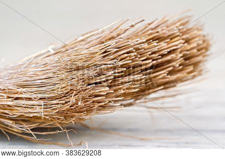 Close Up Of The Head Of An Old Discarded Straw Broom