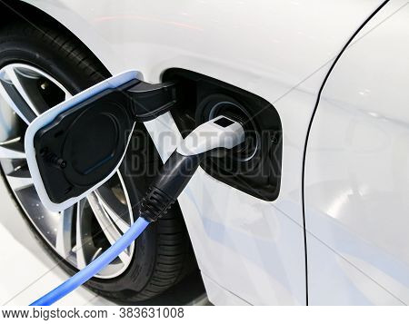 Power Supply Plugged For Electric Car Charging. Charging Station For Electric Car. Ev Car Or Electri