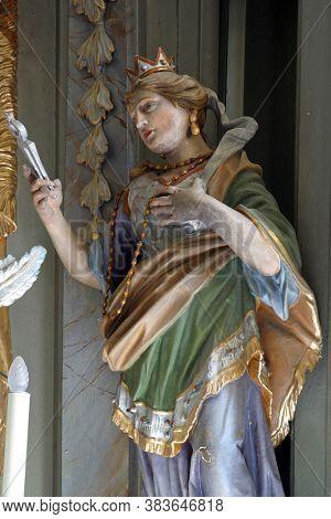 SAMARICA, CROATIA - SEPTEMBER 26, 2011: Saint Apollonia statue on the main altar at St. Catherine of Alexandria Church in Samarica, Croatia