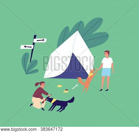 Family On Summer Outdoor Camping Vacation. Young Couple Playing With Dogs Near A Tent. Man And Woman