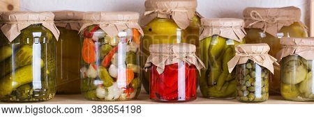 Preserved And Fermented Food. Assortment Of Homemade Jars With Variety Of Pickled And Marinated Vege