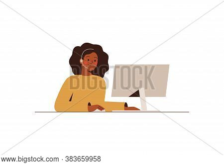 Black Woman With A Headset Is Working At The Computer In The Call Center. African Female Works In Th