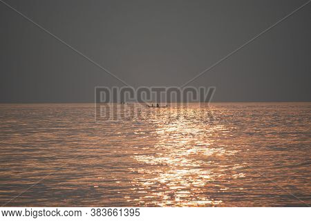 The Sun's Rays Appear Transparent In The Sea Water.sunrise In The Morning From The Clouds At Kovalam