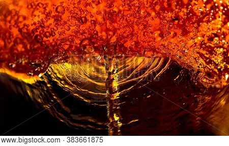The Abstract Splashing Of Carbonated Drink. Macro Shot.