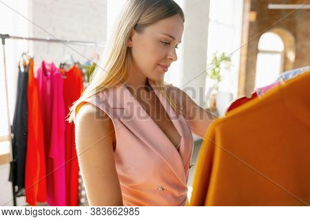 New Dress. Wear, Clothing Shop During Sales, Summer Or Autumn Collection. Young Woman Looking For Ne