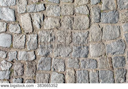 Pavement Of Granite Stone.old Cobblestone Road Pavement Texture. Absrtact Background. Outdoor Closeu