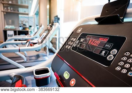 Group Of Treadmills In Fitness Club. Treadmill Running In Exercise Gym. Physical Sport Concept