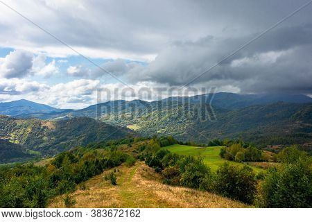 Autumnal Countryside On A Cloudy Day. Beautiful Mountain Scenery Of Carpathians. Abandoned Rural Are