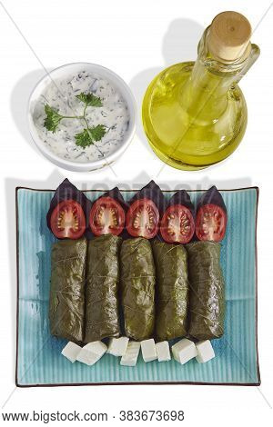 Dolma Of Grape Leaves With Basil, Tomatoes And Feta On A Blue Platter