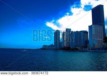 View Of Buildings Next To The Miami South Channel In Brickell Miami, Florida With Blue Sky, Skyline