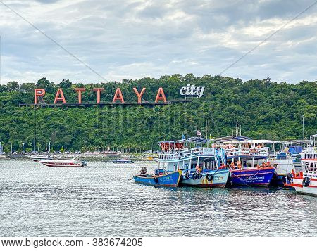 Pattaya Thailand - 28 Aug 2020: Commercial Boats Pattaya Bay With The Pattaya City Sign On The Hill
