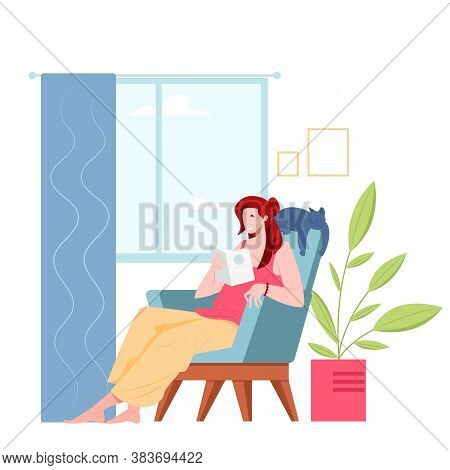 Young Woman Reading Book While Sitting In Chair In Room With Cat. Feminine Daily Life And Pastime Sc