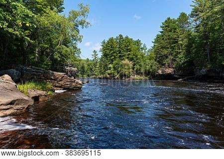 Kettle River Running Through Forest Of Banning State Park In Pine County Minnesota