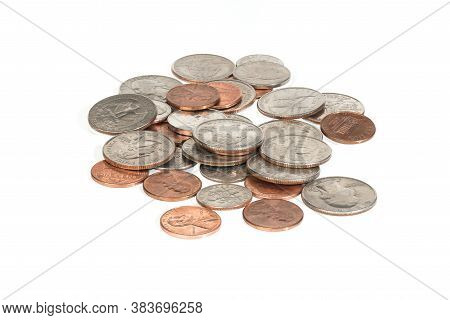 Close Up Of A Pile Of Us Coins- Cents, Dimes And Quarters On White Background