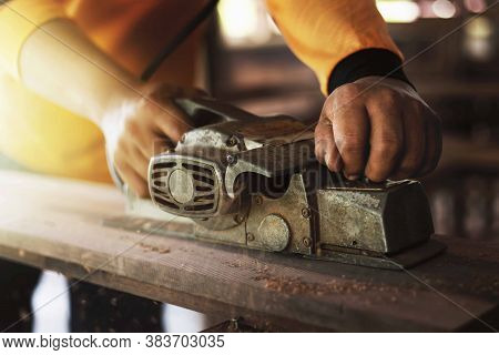 Carpenter Is Using Tools To Clear The Wood, Straighten The Wood.