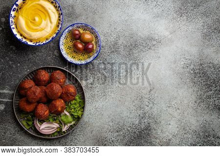 Traditional Middle Eastern Dish Falafel Served With Fresh Green Salad, Hummus And Olives. Arab Or Me