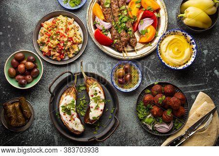 Middle Eastern Or Mediterranean Dinner With Grilled Kebab, Falafel, Roasted And Fresh Vegetables, As