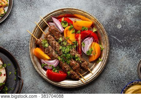 Delicious Meat Kebab With Fresh Vegetable Salad Served On Rustic Plate, Traditional Middle Eastern D